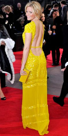 Elizabeth Banks attended the London premiere of The Hunger Games in a Bill Blass gown and Irene Neuwirth moonstone earrings.