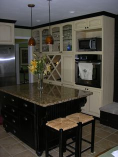 Kitchen Cabinets - dark island with white glazed cabinets and bead board