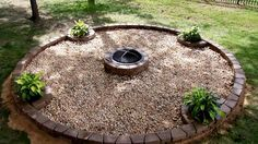 Backyard fire pit how-to -- surprisingly easy and looks great! Love the built-in planters