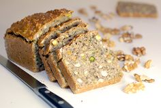 Nutty Bread :This hearty and healthy gluten free, grain free Nutty Bread is packed with walnuts, hazelnuts, pistachios, pumpkin seeds, sunflower seeds and sesame seeds. #glutenfree #bread