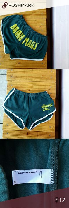 "M AMERICAN APPAREL BRUNO MARS SHORTS -green & yellow moonshine jungle shorts -modern take on the classic 70?s running shorts -elastic waistband -form fitting -approx. 2.75"" inseam (size M, can easily fit S) -100% combed cotton -waist: 27-28"" (according to american apparel size chart) -front rise: 8.5"" -back rise: 10.5"" -good condition & well loved - some fading -comes from a smoke-FREE & pet-FREE home American Apparel Shorts"
