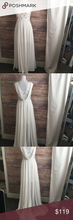 Manga White Beaded Wedding or Formal Gown Size L Manga White Wedding or Formal Gown Size L. Features padded bodice. Fully lined. Sequin trimmed bodice, Draped back. Train. Side zip. Bust 19 Side length Approx 46 (pit to hem). Never worn. NWOT. Asymmetrical hem. Manga Dresses Wedding