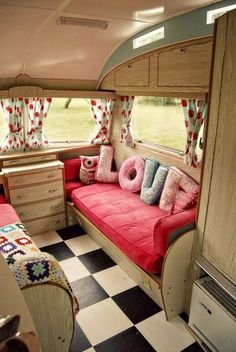 Vintage camper - black white checked floor. I love the cushions. Would look great in a bedroom.