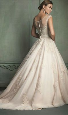 Button back, sheer top, flows out at the bottom. Gorgeous wedding dress!