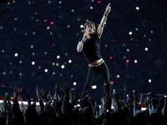 Super Bowl XL (Feb. 5, 2006) | Rolling Stones lead singer Mick Jagger performs during halftime of Super Bowl XL in Detroit.