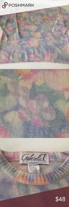 """Gabriella T angora blend Italian size m sweater Have you always wanted to go to Belgium and tiptoe through the tulips? This sweater has tulips and other impressionistic flowers on both the front and the back of the sweater.  The colors are so subtly beautiful and blend together effortlessly.  The sweater is composed of 40% wool, 40% nylon, and 20% angora.  It is soft to the touch and soft in hue!  The sweater measures 27"""" long and has a 46"""" bustline.  Hand washable.  Are you ready to tip toe…"""