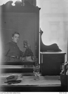 Self portrait of 18 Gunner (Gnr) Thomas Charles Richmond Baker MM and Bar, 16th Battery, 6th Field Artillery Brigade (later No 4 Squadron AFC). Taken using the reflection in a dresser mirror, the Kodak camera is clearly seen beside Gnr Baker. He was reported killed in action, aged 21, on 4 November 1918 after going missing while on offensive patrol over Belgium and is buried at Escanaffles Communal Cemetery, Hainault, Belgium.  He was posthumously awarded the Distinguished Flying Cross.