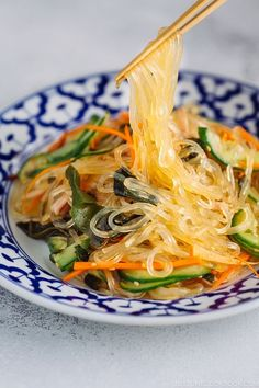Chopsticks holding glass noodles being pulled out from the delicious Harusame Salad (Japanese Glass Noodle Salad) on a blue and white plate. Chopsticks holding g Easy Japanese Recipes, Japanese Dishes, Asian Recipes, Healthy Recipes, Ethnic Recipes, Japanese Salad, Free Recipes, Easy Recipes, Cena Light