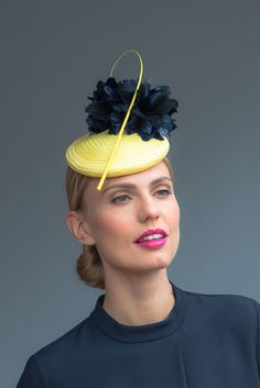 Handcrafted in our London studio.Straw cocktail hat with feathers and quill.Secured with an elastic and comb. Colour: Yellow/Navy.Base-17cm diameter.1 in stock. Delivered in 3-5 business days. Sent free within the UK. Includes a Black