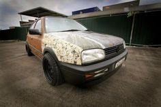 Guy originally bought it for 1600, now selling for 2300.    Features rusted body -rusted using various foreign and domestic beers (who said Australians aren't culturally conscious?) and Moog's piss.    Anime decopage because its cheaper than stickerbombing and thats what the kewl kidz on the internet are doing.    Interim owner did replace gearbox, Car does have reverse gear now  Ehh.. after this episode my life was complete.. MCM+building VW, what can be better?
