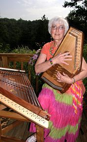 Posing with my two favorite instruments. Didn't start playing the hammered dulcimer until I retired at age 62.  Started playing the autoharp at about age 70.  Have really enjoyed them both.