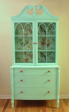 Old china cabinet given new life w/mint green paint and wallpaper.