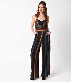 Keep it retro, darling! A striped 1970s style jumpsuit that's sure to stun and spellbound, complete in a jet black and featuring multicolor striped pattern for a true disco vibe. This psychedelic piece is crafted in a lightweight crepe, boasting a V-neckl