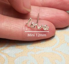 MINI Love Cartilage Earring, Sterling Silver - FREE Toe Ring from wirewrap on Etsy. Saved to Earrings. Piercing Tattoo, Ear Piercings, Peircings, Cute Earrings, Heart Earrings, Cute Jewelry, Jewelry Accessories, Jewlery, Glitz And Glam