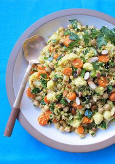 Moroccan-Spiced Roasted Cauliflower and Carrot Salad with Chickpeas and Couscous