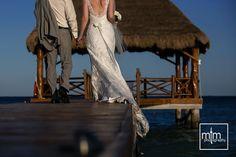 Newlyweds walk down the pier. Azul Fives Wedding Photographer. Playa del Carmen photography. Unique wedding ideas. Wedding dress & rings. Riviera Maya Best Destination Mexico.