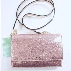 Kate Spade pink glitter bug cami Beautiful bag. Planned on keeping for myself but had an emergency so I need to sell it. Bought at Dillard's and paid full price. All original tissue included. 14k light gold hardware.                                                                                                           NO TRADES/ PAYPAL ✔DON'T ASK FOR MY LOWEST PRICE, PLEASE USE OFFER BUTTON ❤️BUNDLE TO SAVE! ⏳I ONLY HOLD ITEMS FOR 24 HOURS kate spade Bags Crossbody Bags