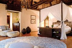 South Pacific inspired bedroom design...check the beautiful beams!