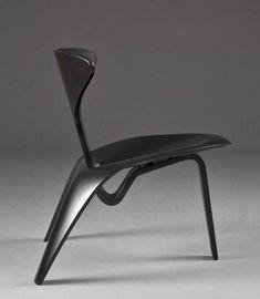 """Shell chair"" by Poul Kjærholm. Black wood."