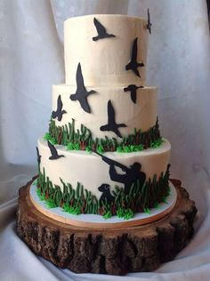 Grooms Cake - Duck hunting with the groom's Great Dane.  Yellow cake, chocolate filling, vanilla buttercream icing.  Hand-cut fondant accents