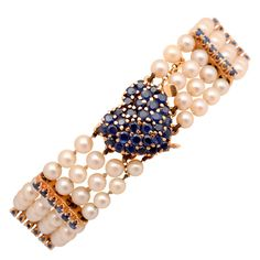 Tiffany Pearl Bracelet with Sapphire Heart | From a unique collection of vintage beaded bracelets at http://www.1stdibs.com/jewelry/bracelets/beaded-bracelets/