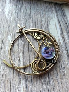 Brass Shawl Pin or Scarf Pin or Sweater Pin (fastener, fibula, brooch) in Crescent Moon Design The mood of this brooch or shawl pin is nature inspired , romantic, feminine Technique:This brass shawl pin or scarf pin is hand-formed, hand-hammered, and wire wrapped by Lirimaer.