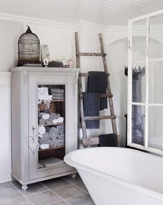 decorating with ladders_bathroom with big old cupboard and ladder for towels