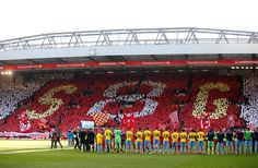 General view of players forming a guard of honour as Liverpool's Steven Gerrard comes out for his final game at Anfield