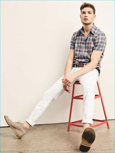 Gap stands by casual style with white denim jeans and a short sleeve plaid shirt.