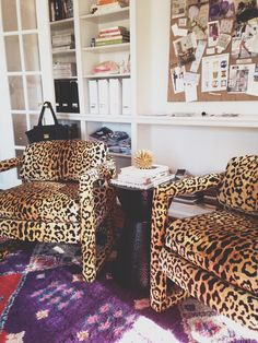 Milo Baughman chairs upholstered in leopard fabric? Is this a dream?!