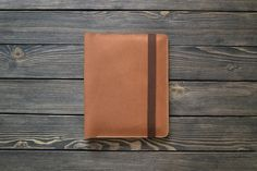iPad and document organizer. 9.7 inch iPad Pro case. iPad leather folio brown color. Cut and pierced by hands. Moreover, it's sewn by hands but not with a machine, what makes it even more precious. Your initials or other information can be added with stamping method.  SIZE: W*H 220*275 mm (8.6*10.8 in)  *This folio fits the iPad Pro 9.7 inch with a keyboard cover.  Genuine leather, 2 mm, waxed thread, metal button.  This folder will be essential during your holidays and business-trips…