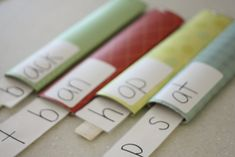 Paper towel tube & paint stirrer stick word family activity.  Another version of Kari's idea.