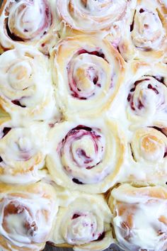 Raspberry Sweet Rolls Recipe on twopeasandtheirpod.com Soft and sweet raspberry yeast rolls topped with cream cheese frosting. These rolls are amazing! and perfect for breakfast or brunch!