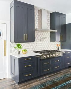 love love love this whole thing! The navy cabinets, the tile backsplash, the flooring...