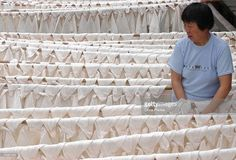 A worker dries silk rolls at a silk workshop on June 11, 2005 in Huzhou of Zhejiang Province, China. China has had the name of ' Country Of Silk' since ancient times and has a history of nearly 5,000 years. The country remains the worlds largest silk exporter.