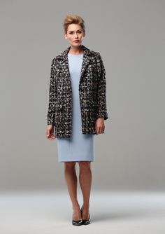 TWEED JACKET WITH WOOL CREPE DRESS  Tweed loosely fitting jacket with side splits and single button fastening, with a pale blue wool crepe shift dress with short sleeves.
