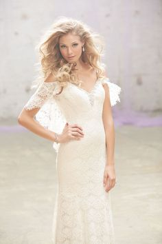 Madison James MJ111 - Crisp cotton lace is used for a uniquely delicate sleeve, trailing to a dramatic back. Vintage Style Bridal Gowns   Brides of Melbourne