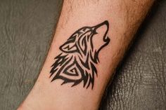 Tribal Wolf Tattoo... on the upper arm maybe?