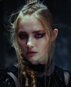 She likes to braid her strawberry blonde hair and wears khol black liner around her seagreen eyes