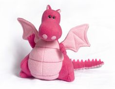 I love dragons.  This guy has lots of personality.  Found in fabrickitchen's etsy shop.
