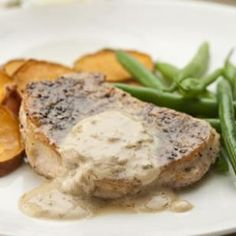 Pork Chops au Poivre | These French-style pork chops get a rich flavor from the sour cream and brandy sauce smothered on top.