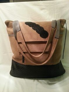 Here's one of my new bags!!  This is made with faux suede and basket weave black vinyl.  It's really big. Large enough to use as an overnighter. 2 zip pockets on the outside with a zip closure.
