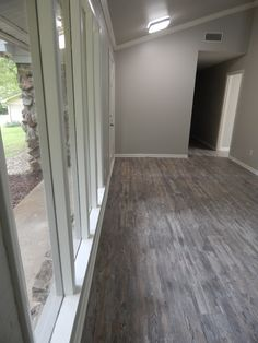 floors: kronoswiss noblesse historic oak 8mm; walls:  sherwin williams repose gray sw 7015; trim: sherwin williams greek villa sw 7551