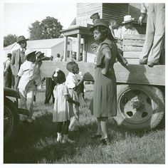 An woman buying ice-cream for children from a truck, Natchitoches, Louisiana.