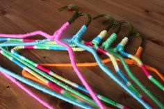 DIY NEON NONSLIP HANGERS. Perfect for those silky blouses that fall off the hanger, EVERY SINGLE TIME.