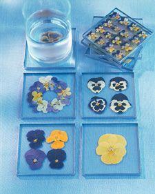 You could probably insert a variety of items between the glass squares and make beautiful coasters.