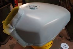 Spray putty on a motorcycle tank