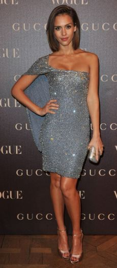 Who made  Jessica Alba's silver one shoulder dress and clutch that she wore in Paris on January 25, 2011?