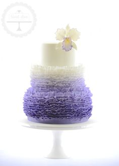Wedding cake with ombre purple ruffles and feature sugar orchid