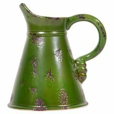 """Display a blooming bouquet in this vintage-inspired pitcher, showcasing a distressed green finish.   Product: PitcherConstruction Material: TinColor: Distressed greenDimensions: 7.87"""" H x 7.48"""" W x 6"""" D"""